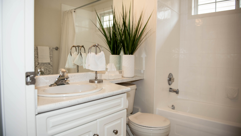 refinished bathtub and countertop in bathroom